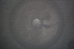 Speaker metal grid. Speaker seen trought the metal grid Royalty Free Stock Photo