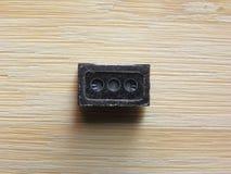 Speaker component of smartphone. Speaker micro component of smartphone kept on wooden table stock images
