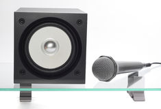 Speaker with microphone. Broadband speaker with microphone on the glass table Stock Photo