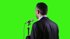 Speaker with microphone on green screen Stock Photography