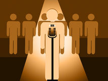 Speaker or Performer On the Spotlight Behind A Microphone Royalty Free Stock Photos