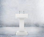 Speaker podium tribune rostrum stand with microphones. Debate, press conference Stock Images