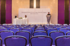 Speaker prepares to lecture before people come meeting room.  Royalty Free Stock Photography