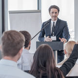 Speaker at presentation to audience stock photo