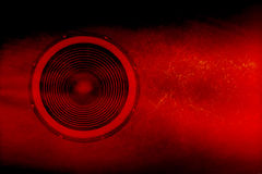 Speaker on a red grunge background Stock Images