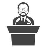 Speaker at rostrum - man in glasses at tribune Stock Photography
