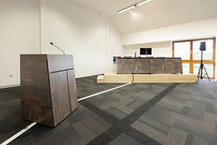 Speaker's table in modern conference hall Royalty Free Stock Photos