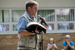 Speaker shares skunk with students Royalty Free Stock Photos