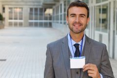 Speaker showing his id badge.  Royalty Free Stock Image