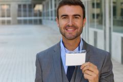 Speaker showing his id badge Stock Images