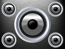 Speaker on a silver metal texture. A speaker on a silver metal texture Royalty Free Stock Images