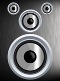 Speaker on a silver metal texture. A speaker on a silver metal texture Royalty Free Stock Photography
