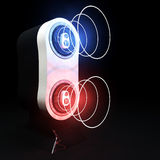 Speaker With Sound Waves. A stylized speaker with abstract type of representation of sound waves with red and blue colors Stock Image