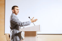 Speaker at stage Royalty Free Stock Photo