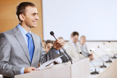 Speaker at stage Royalty Free Stock Image