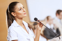 Speaker at stage Stock Photography