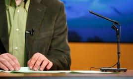 Speaker talking in TV studio. Speaker talking to the  microphone - TV studio Royalty Free Stock Photography