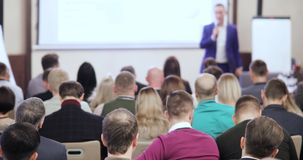 People at a conference or presentation, workshop, master class photograph. Back view stock video