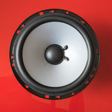 Speaker unit on red background Stock Photos