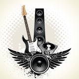 Speaker with wings. And instruments on grunge background Stock Image