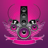 Speaker with wings. And equipment on grunge background Royalty Free Stock Image