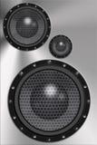 Speakers. Three loud speakers in steel background Royalty Free Stock Images