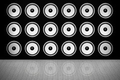 Speakers. Background of black wall with rows of white speakers Royalty Free Stock Photography