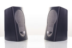 Speakers. Two computer speakers, with a reflection on white background royalty free stock photos