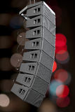 Speakers. Set of powerful speakers with blurred lights in background royalty free stock image