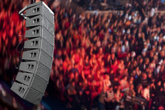 Speakers. Set of powerful speakers with audience in background stock photos