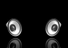 Speakers. Illustration of two speakers with reflection isolated on black and with space for text Stock Images