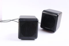 Speakers. A pair of speakers in black on a white background Royalty Free Stock Images