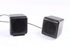 Speakers. A pair of speakers in black on a white background Stock Images
