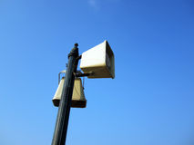 Speakers and blue sky. White two speakers against blue sky Royalty Free Stock Images