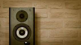 Speakers on the brick wall background stock photo