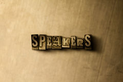 SPEAKERS - close-up of grungy vintage typeset word on metal backdrop Stock Photography
