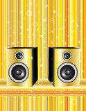 Speakers on gold background Stock Images