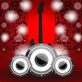 Speakers and guitar on beautiful shiny red abstrac Royalty Free Stock Photos