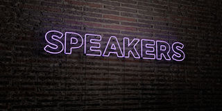 SPEAKERS -Realistic Neon Sign on Brick Wall background - 3D rendered royalty free stock image Royalty Free Stock Photography