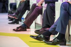 Speakers shoes at the conference. Speakers shoes at the business conference Royalty Free Stock Image