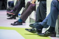 Speakers shoes at the conference. Speakers shoes at the business conference Royalty Free Stock Photo