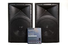 Speakers and sound mixer on white Stock Photos