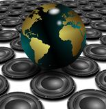 Speakers and world. White floor covered with black speakers and earth globe above them Royalty Free Stock Photography