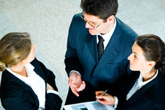 Speaking businesspeople Stock Images