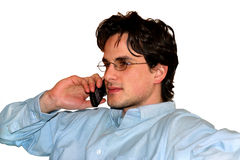 Speaking in cell phone. Isolated young man with mobile phone Stock Photo