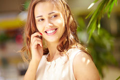 Speaking on cellphone Royalty Free Stock Images