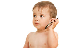 Speaking over mobile serious toddler Royalty Free Stock Photo
