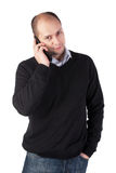 Speaking on the phone. Young adult man speaking on the mobile phone Royalty Free Stock Photo