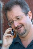 Speaking on phone. Man speaking on cell phone Stock Image