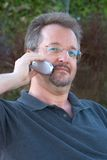 Speaking on phone. Man speaking on cell phone Royalty Free Stock Images